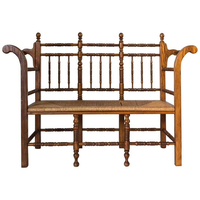 Dark Oak Edwardian Spindle Bench with Rush Seat For Sale