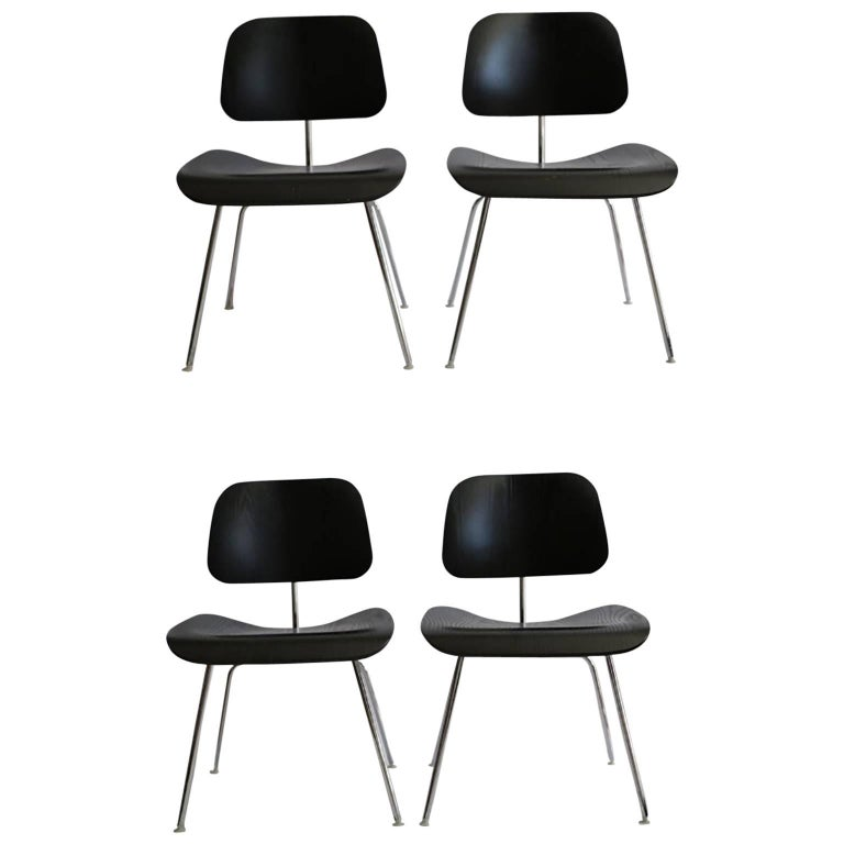 Eames Molded Plywood Dining Chairs with Chrome Legs for Herman Miller circa 2000 For Sale