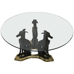 Three Bronze Greyhounds with a Glass Top Coffee Table