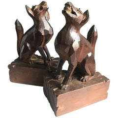 Early 20th Century Hand-Carved and Stylized Dogs Playing Fetch Sculptures, Pair