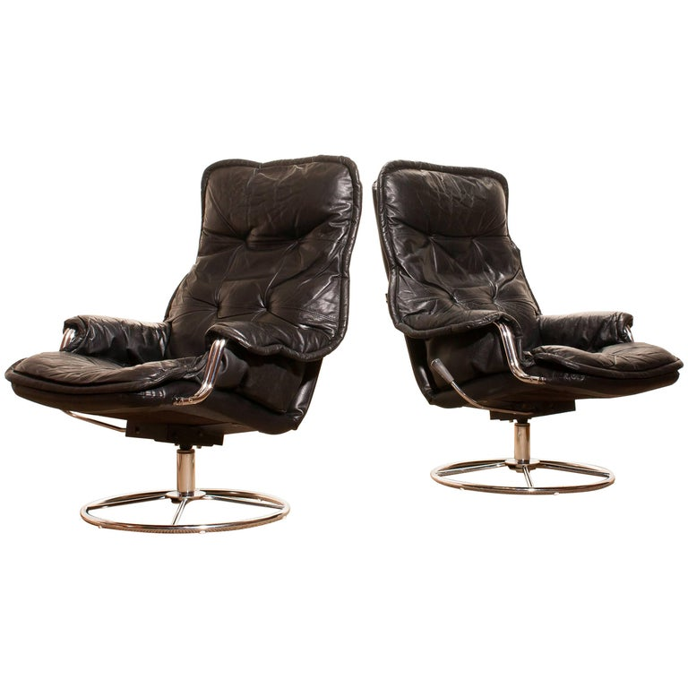 1970s, a Pair of Black Leather Swivel Chrome Steel Lounge Chairs , Sweden