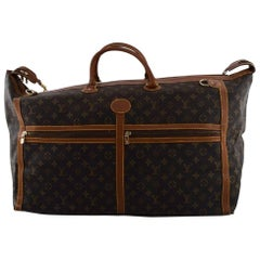 Louis Vuitton: Large vintage travel bag of monogram canvas