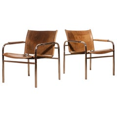 1960s , A pair of Leather and Tubular Steel ArmChairs 'Klinte' by Tord Björklund