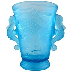 Lalique style art glass vase in turquoise with seahorses in relief.