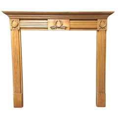 Aged Georgian Style Carved Pine Fireplace Surround.