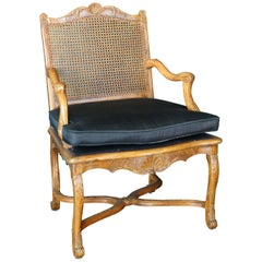 French Régence Carved and Caned Beechwood Fauteuil