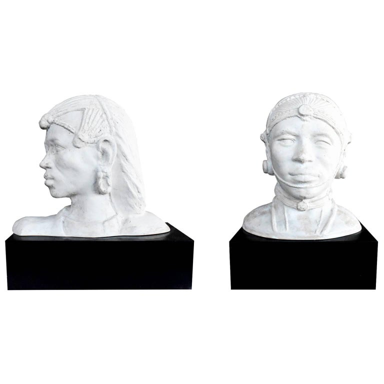 Pair of Resin African Busts with Plaster Finish on a Black Wooden Pedestal