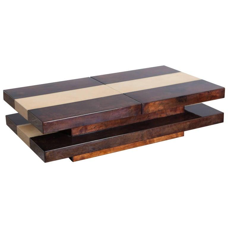 Aldo Tura two tier sliding coffee table with hidden bar