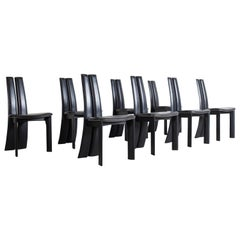 Mid-century modern sculptural ebonized dining chairs, set of eight