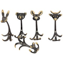 A set of five animal WALTER BOSSE HERTHA BALLER coat hooks of brass