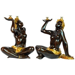 Pair of Mid-20th Century Carved Ebonized and Gilt Female Blackamoor Table Bases