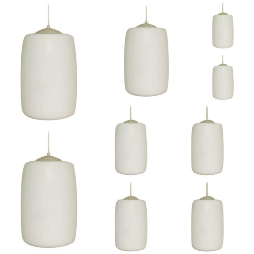 Large Stock, Set of 42 Opaline Glass Pendant Lights, Netherlands, 1960s