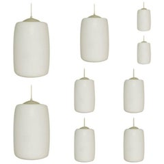 Large Stock, Set of 42 Opaline Glass Pendant Lights, Netherlands, 1960s