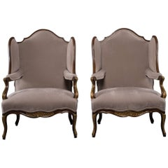 Pair of French Walnut Wing Chairs with Gilt Detailing