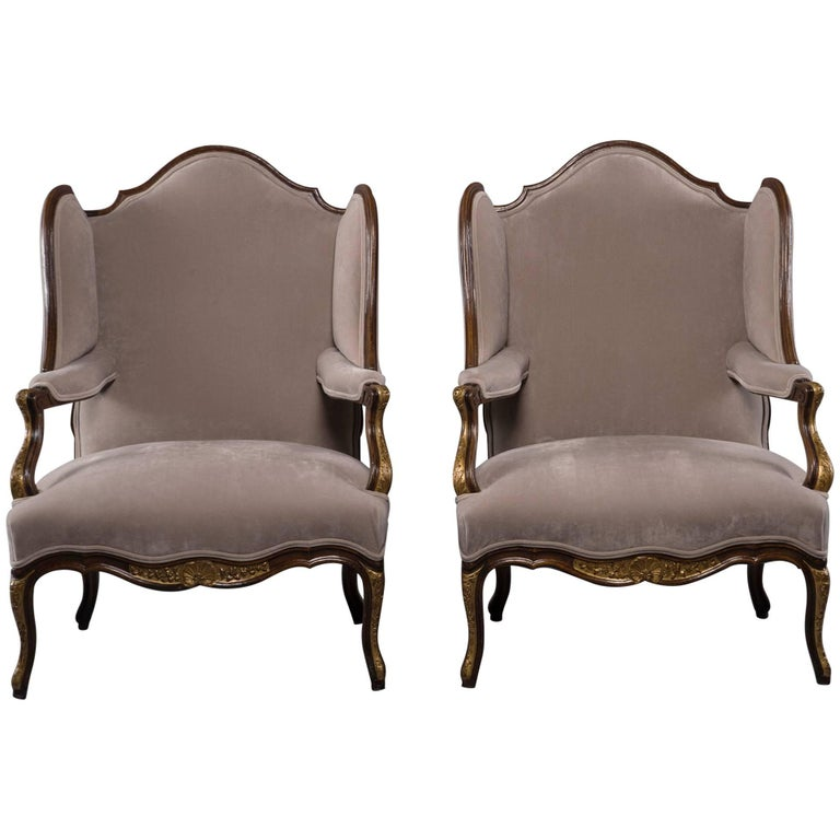 Pair of French Walnut Wing Chairs with Gilt Detailing For Sale
