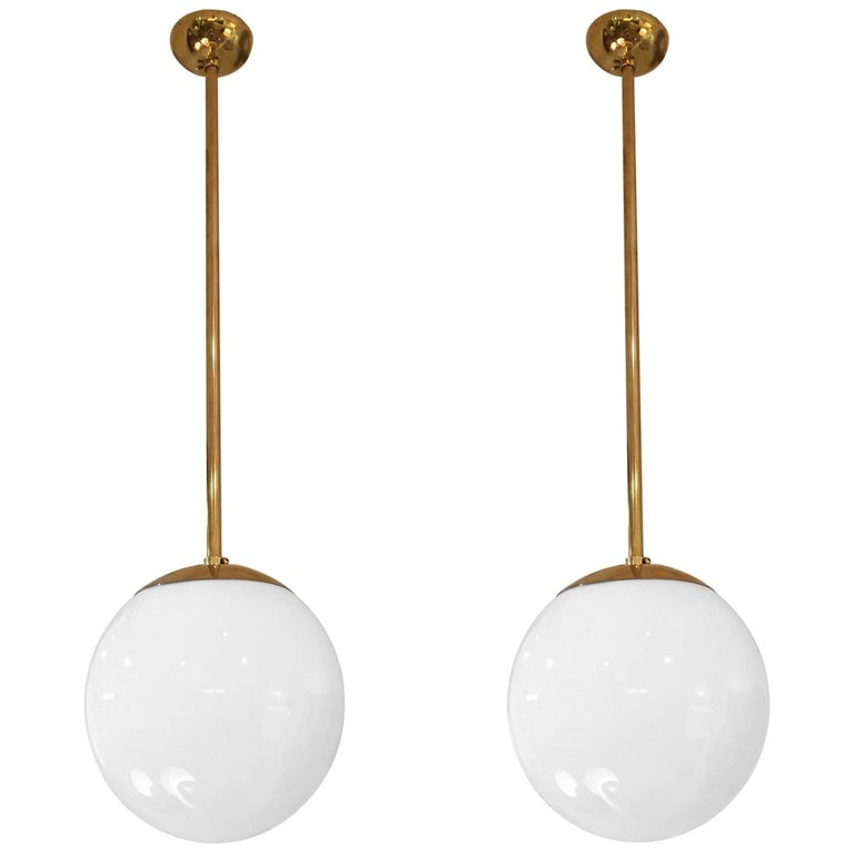 Pair of Midcentury Brass and Glass Globe Ceiling Lights