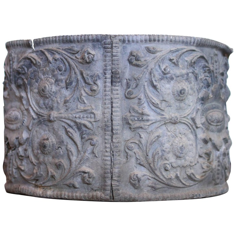 This antique lead planter has elaborate Renaissance Cartouche relief with panelled sides depicting scrolls and rosettes with a centre cartouche. Lead planters were popular in the 19th century and are perfect in a garden or any interior vignette.