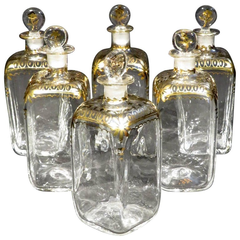 A Rare Set of Six Dutch Colonial 'Gujarat' Glass Decanters, India Circa 1750