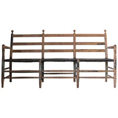 Rustic Ladder Back Bench with Spindle Details and Black Rush Seat