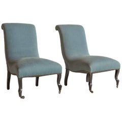 Pair of French Slipper Chairs on Casters Newly Upholstered in Blue Fabric