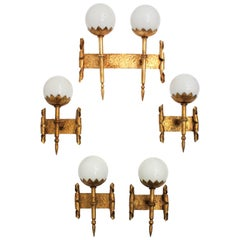 Set of Five Gothic Revival Hammered Gilt Iron and Glass Torch Sconces, France