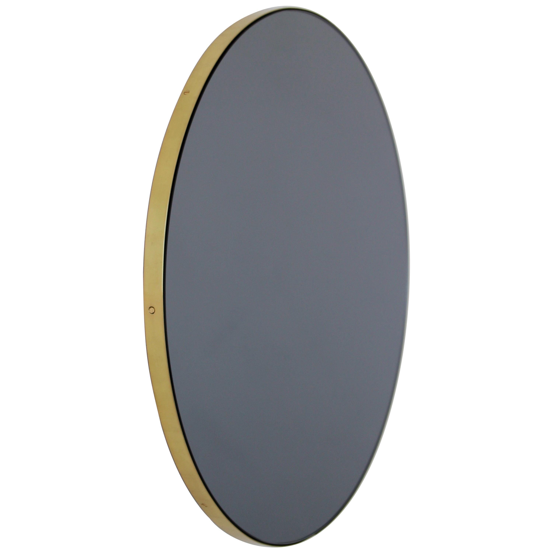 Orbis™ Black Tinted Round Modern Handcrafted Mirror with a Brass Frame - Regular
