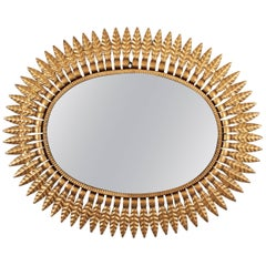 Spanish Mid-Century Modern Gilded Metal Oval Sunburst Mirror