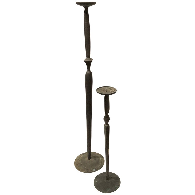 Pair of Patinated Cast Bronze Giacometti Style Tall and Short Candleholders