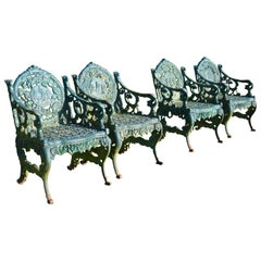 Set of Four Cast Iron Garden Armchairs, Four Seasons Plaques on the Backs