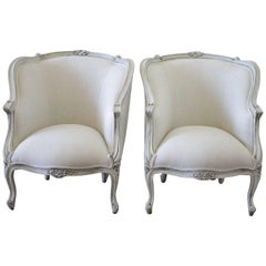 20th Century Painted and Upholstered Pair of Linen Bergere Chairs
