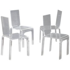 Four Plexiglass Chairs