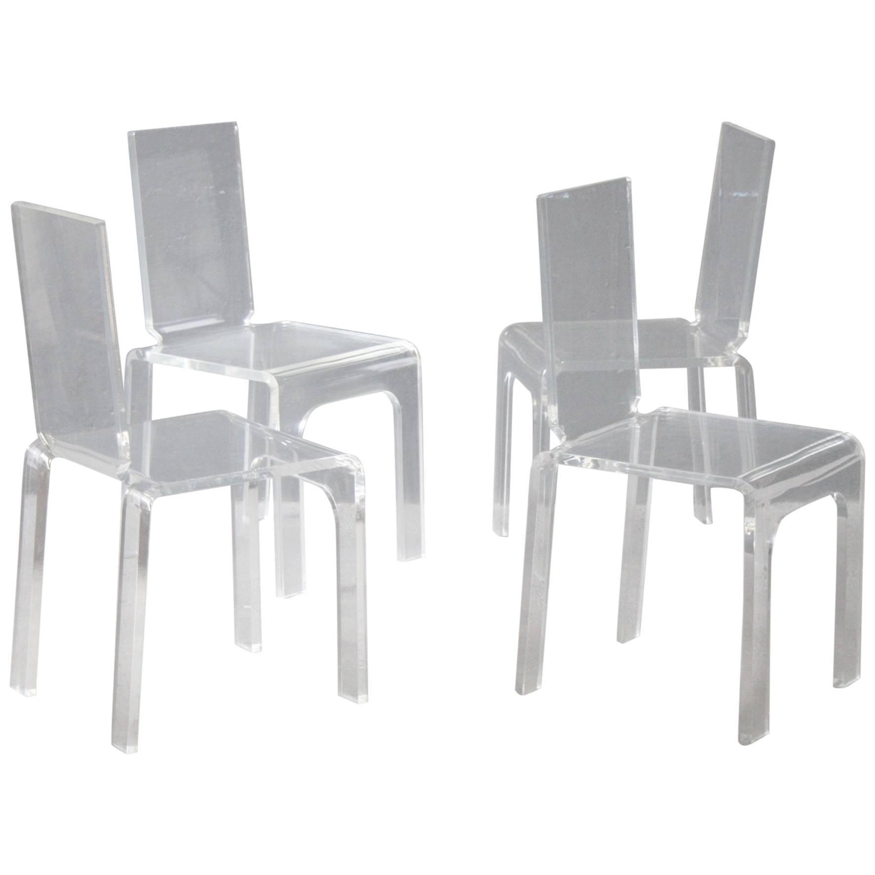 Four Plexiglass Chairs