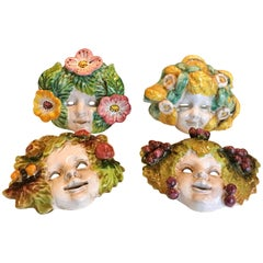 Four Italian Art Deco Majolica Wall Masks