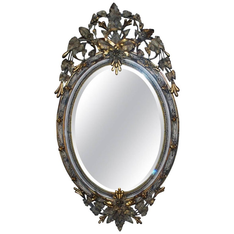 19th Century Large Scale Oval Gilt Mirror with Crest For Sale