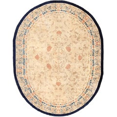 Oval Antique Ivory Cloud Band Background Chinese Rug. Size: 9 ft x 11 ft 7 in
