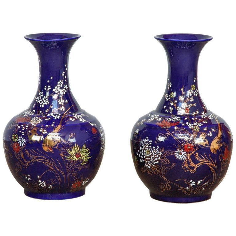 Pair of Chinese Cobalt Blue Flora and Fauna Trumpet Vases