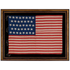38 Stars and a Very Unusual Complement of 31 Stripes on an Antique American Flag