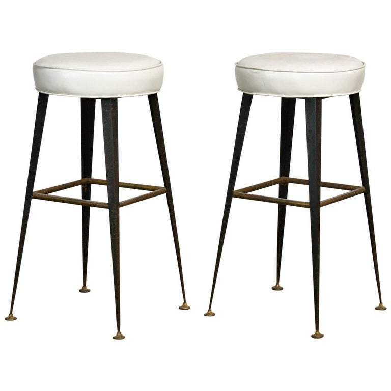 Pair of Midcentury Industrial Iron and Vinyl Barstools