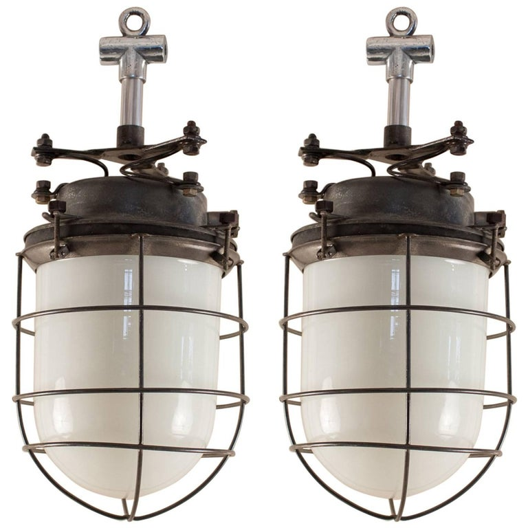 Pair of Nautical or Industrial Milk Glass and Steel Caged Pendant Lights
