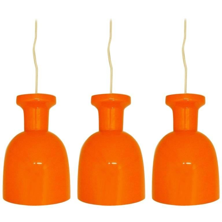 Set of 3 Mandarin Orange Glass Lamps by RAAK Amsterdam. Netherlands, 1970s