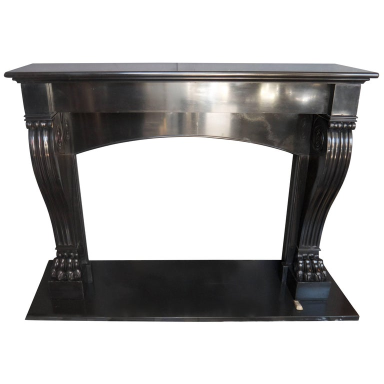 Antique Black Belgian French Fireplace mantle piece with an arched lintle.   For Sale
