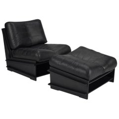 100xbtr Contemporary DB Chair with Ottoman in Black Leather and Paperstone Base