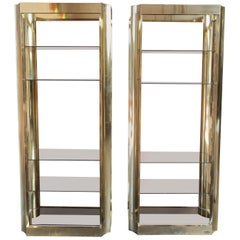 Pair of Brass Etegeres with Smoked Glass Shelves and Beautiful Curved Design