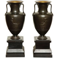 Pair of Exceptional 19th Century French, Bronze Urns with Black Marble Bases