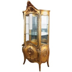 Antique French Rococo Bow Front Carved Giltwood and Ormolu Mirror Back Vitrine