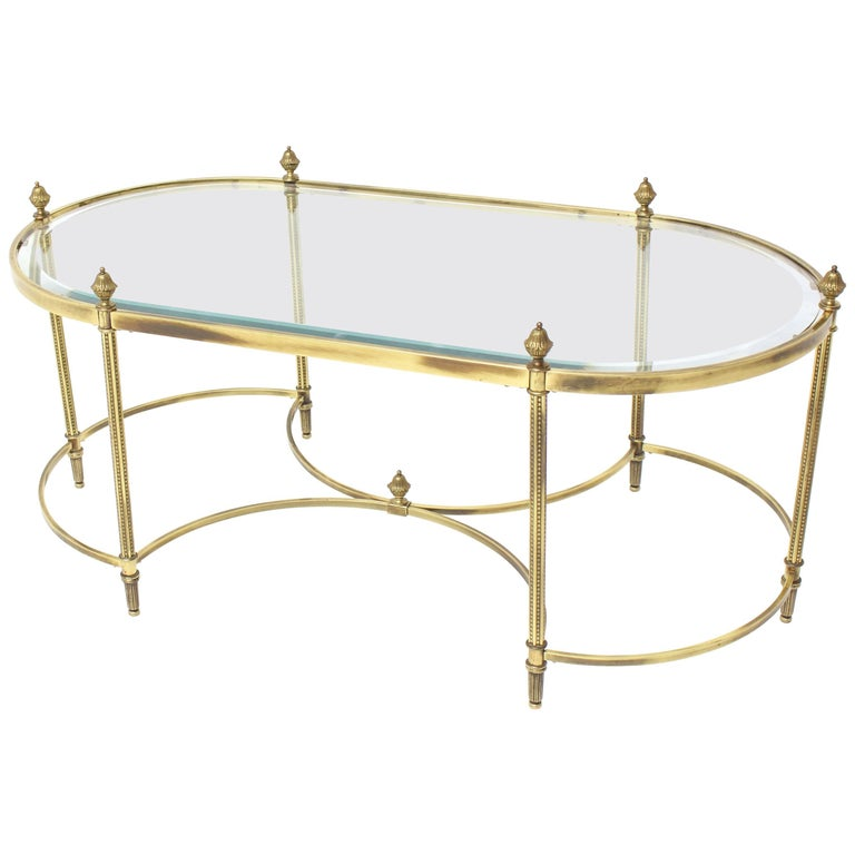 Oval Glass and Brass Coffee Table with Finials Circular Base Stretchers