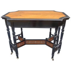 Lambs of Manchester, Aesthetic Anglo Japanese Ebonised & Amboyna Eight Leg Table