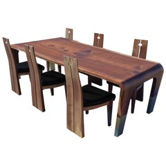 oneTree Walnut Slab Dining Table and Chairs with Bronze Leg and Key Detail