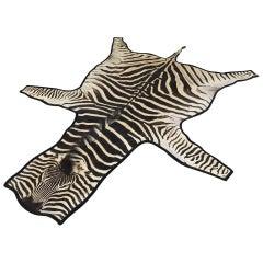 Forsyth Zebra Hide Rug Trimmed in Black Velvet