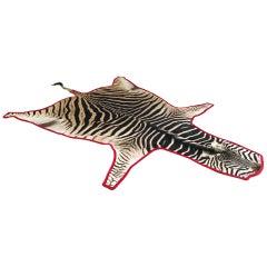 Forsyth Zebra Hide Rug Trimmed in Red Velvet
